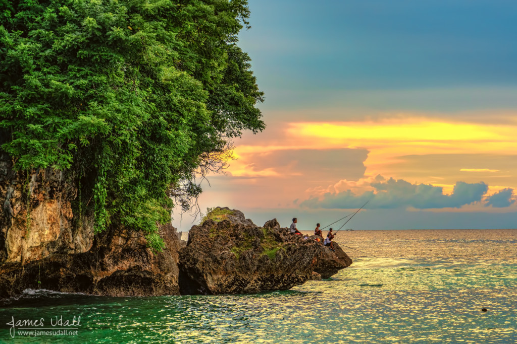 Locals fishing at Padang Padang - Bali, Indonesia