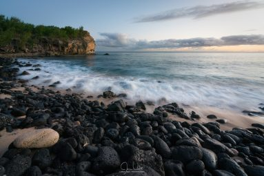Rocky Beach in Kauai at Sunset